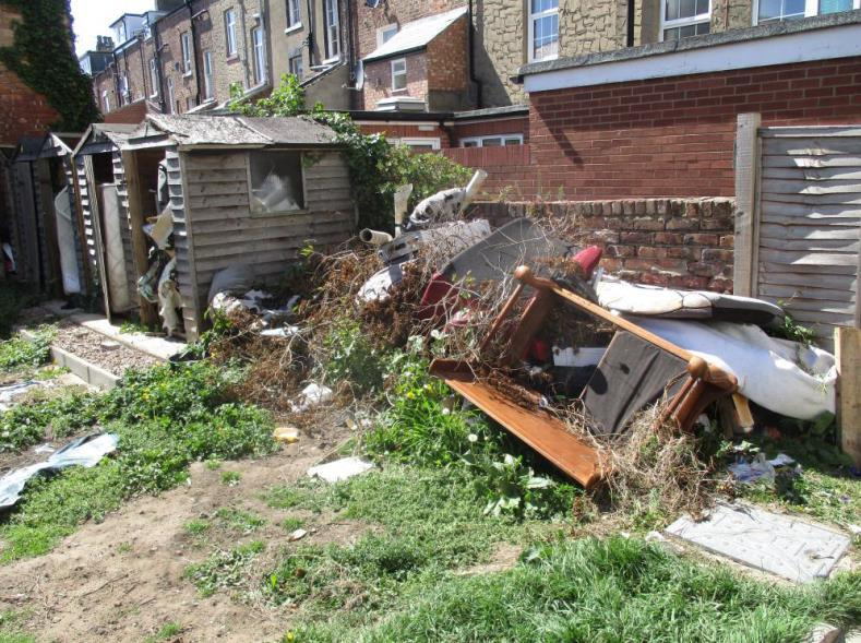 Image of the rubbish at the rear of one of the landlord's properties