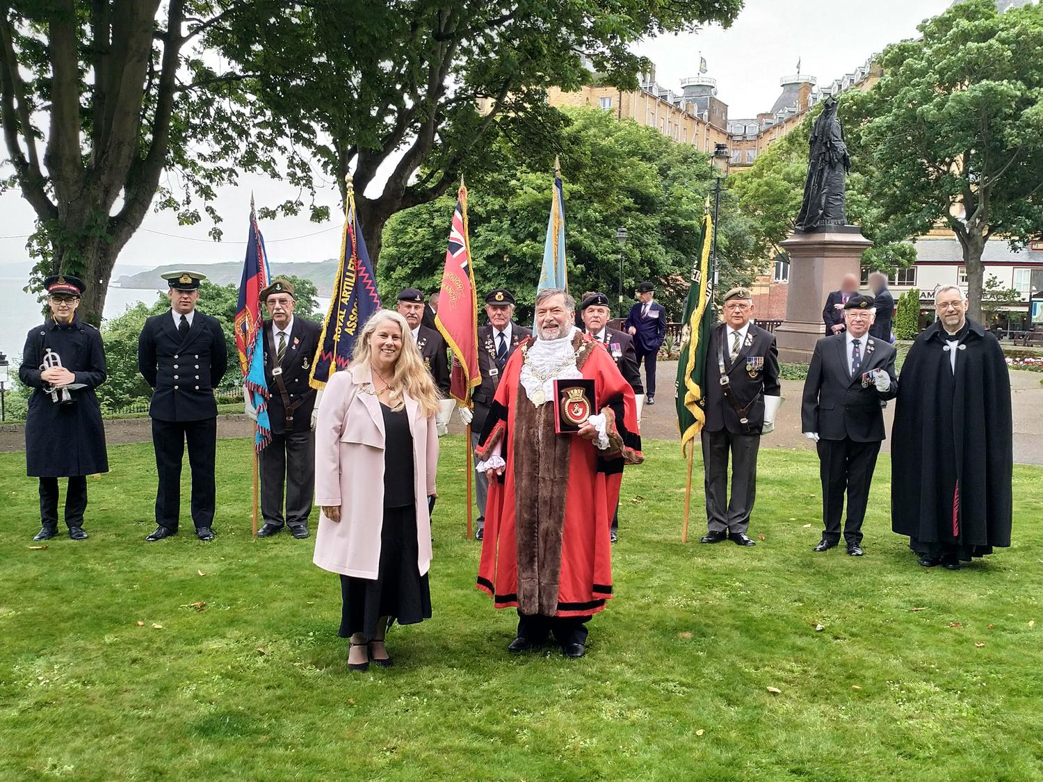 Picture of borough Mayor and Mayoress and standard bearer veterans after Town Hall flag flying ceremony