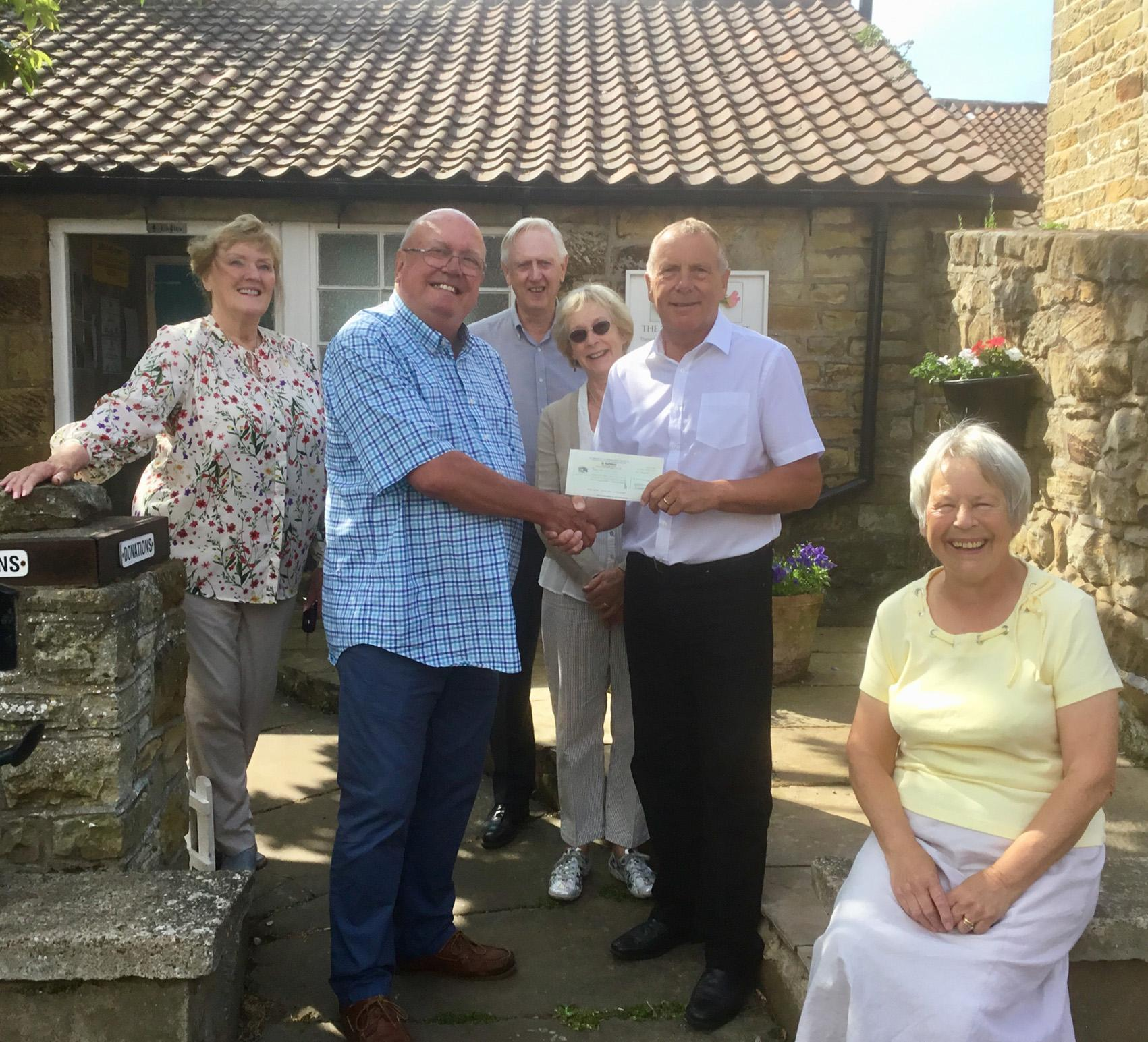 Picture of cheque presentation to Sweet Pea Toilet Trust
