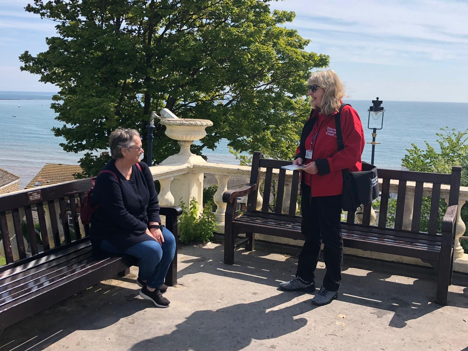 Picture of welcome ambassador greeting a visitor in Filey