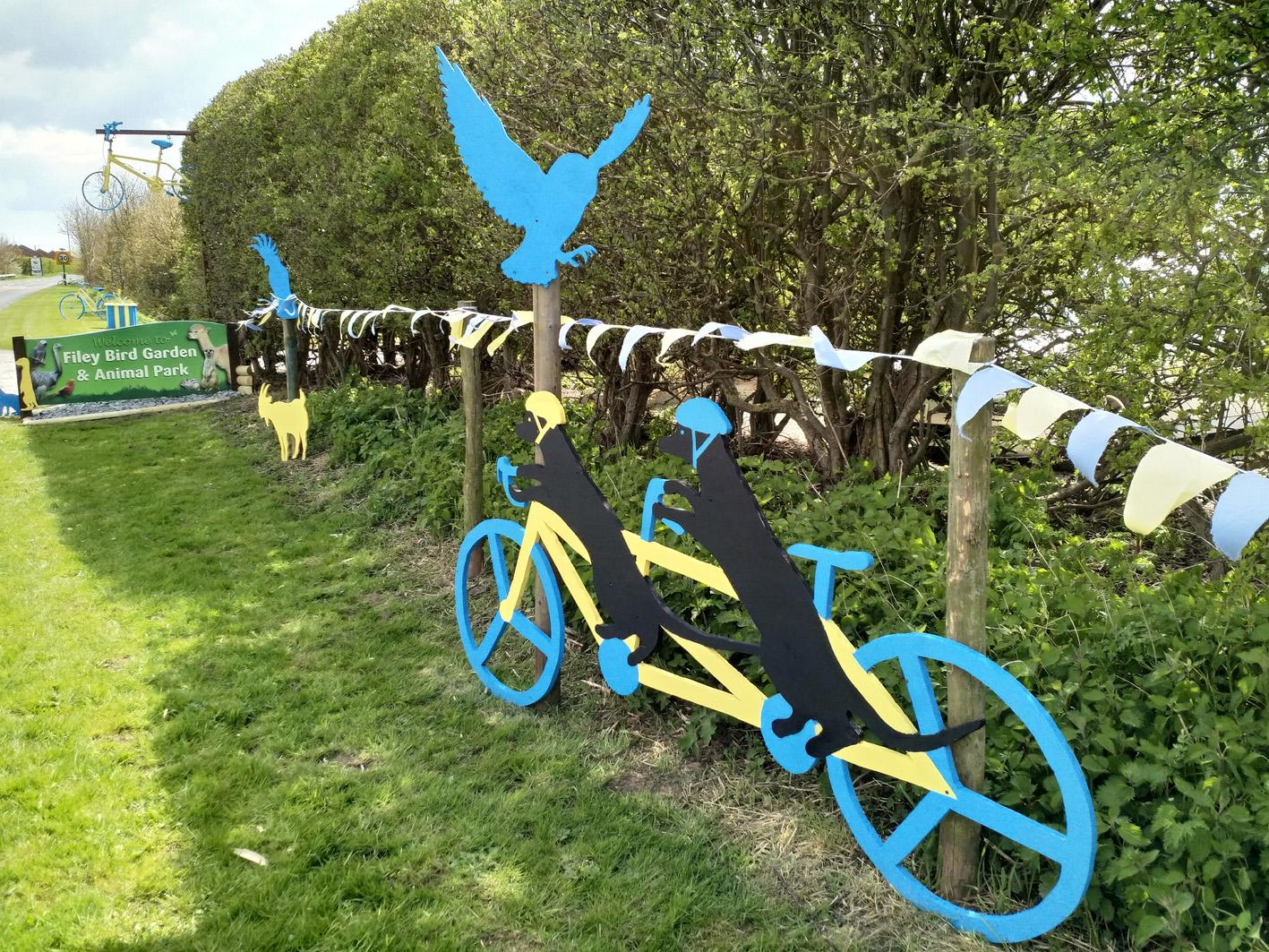 Picture of yellow and blue wooden animal street decorations at Filey