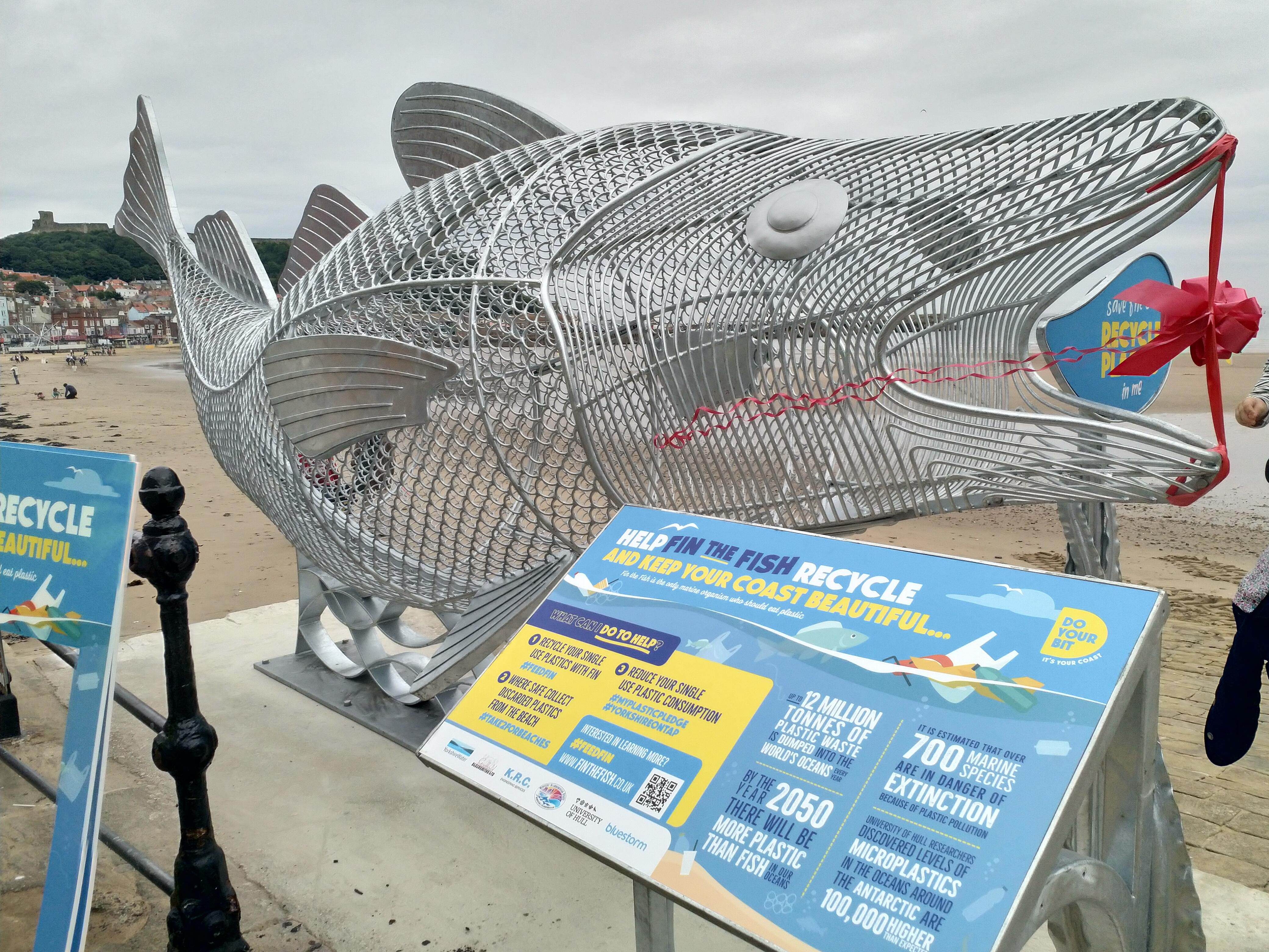 Picture of the Fin the Fish sculpture and receptacle