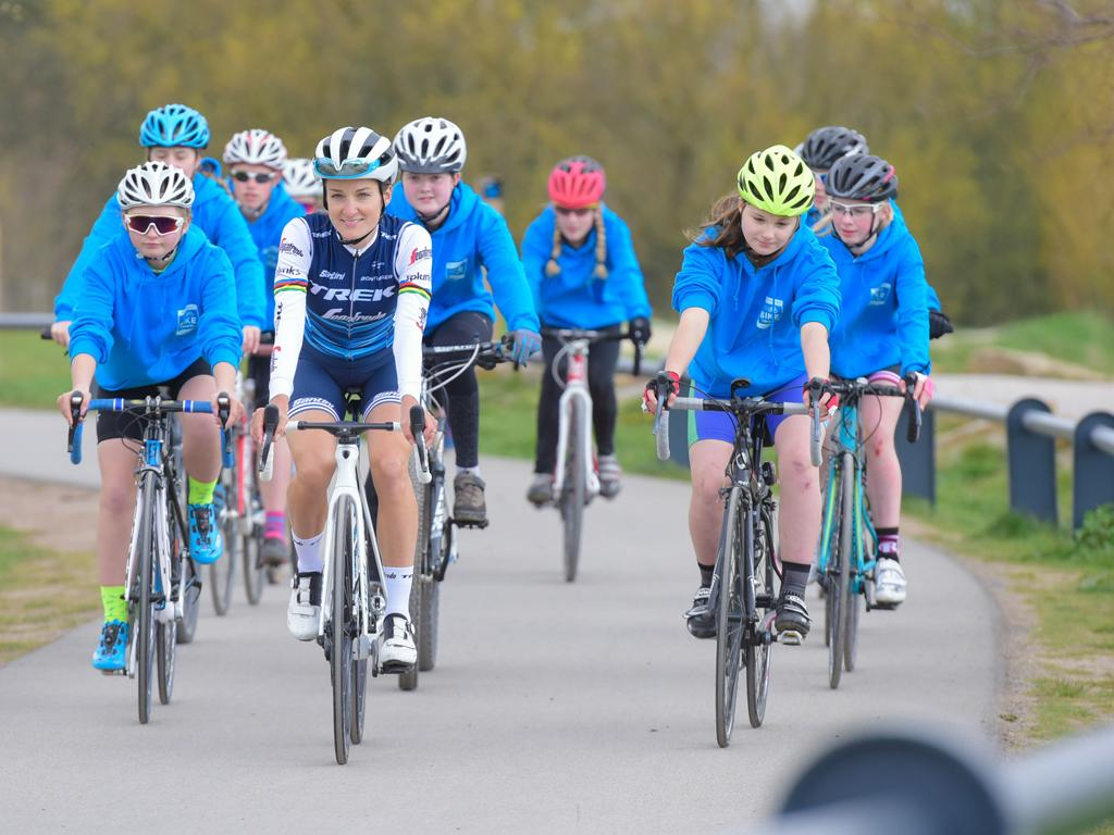 Picture of Lizzie Deignan cycling with young cyclists that have been helped by the Yorkshire Bank Bike Library at Leeds Urban Bike Park