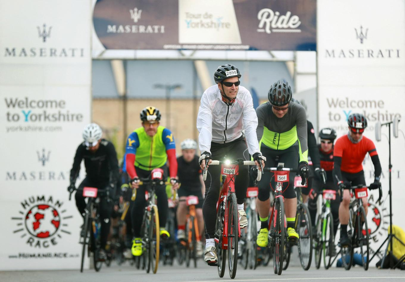 Picture of riders crossing the start line of a previous edition of the Maserati Tour de Yorkshire Ride