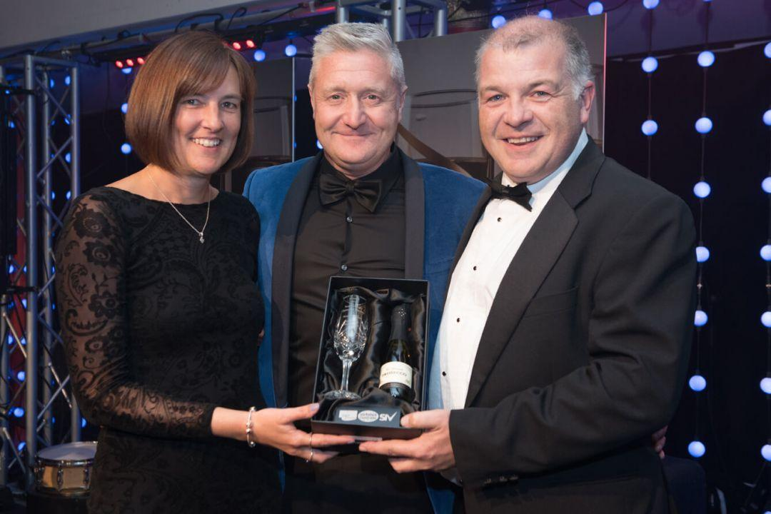 A picture of council officers Nicola Ware and Stuart Clark receiving the Toast of the Coast Best Attraction Award for Scarborough Open Air Theatre