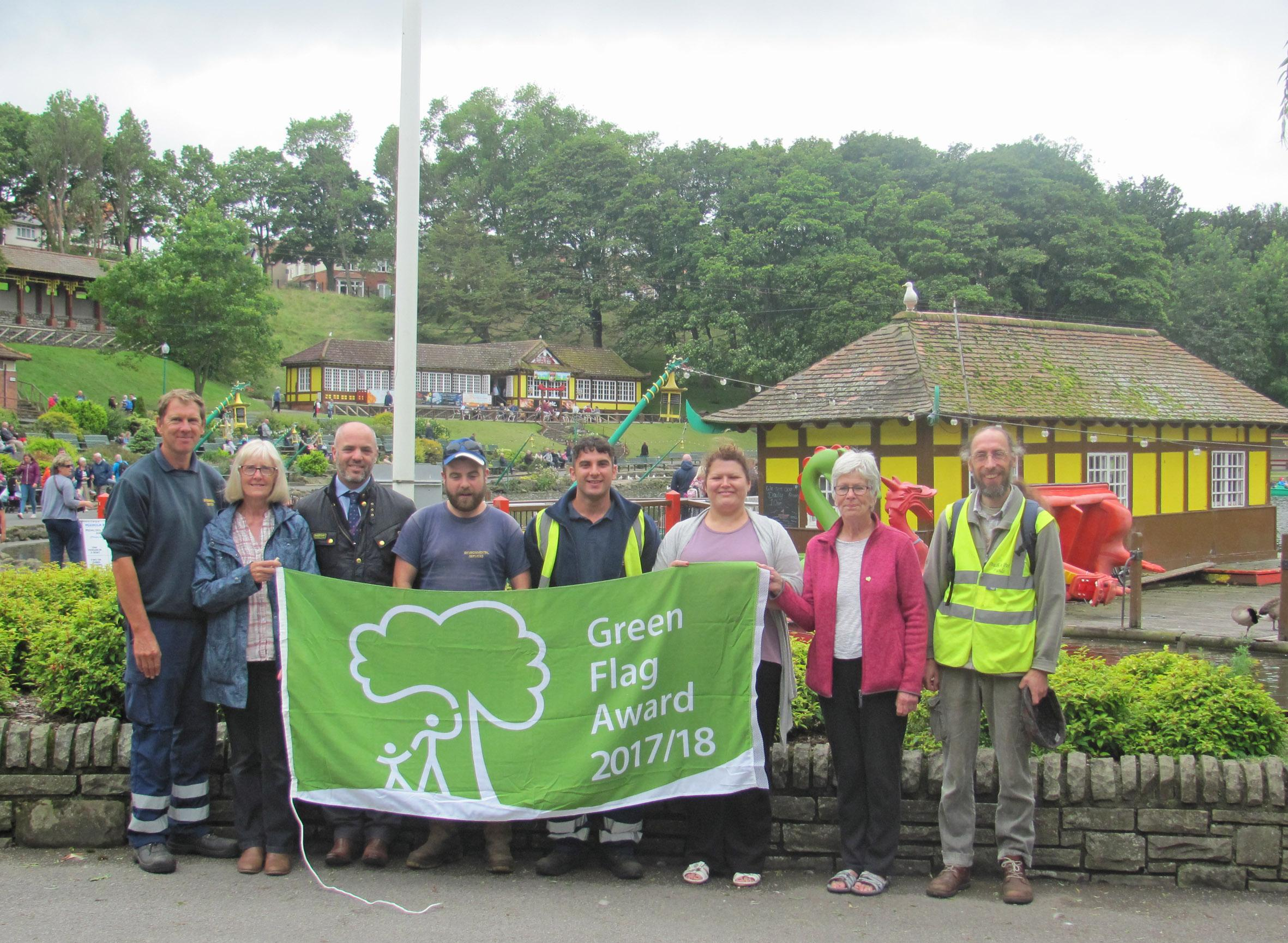The Friends of Peasholm Park and council staff hold aloft the 2017 Green Flag Award in Peasholm Park
