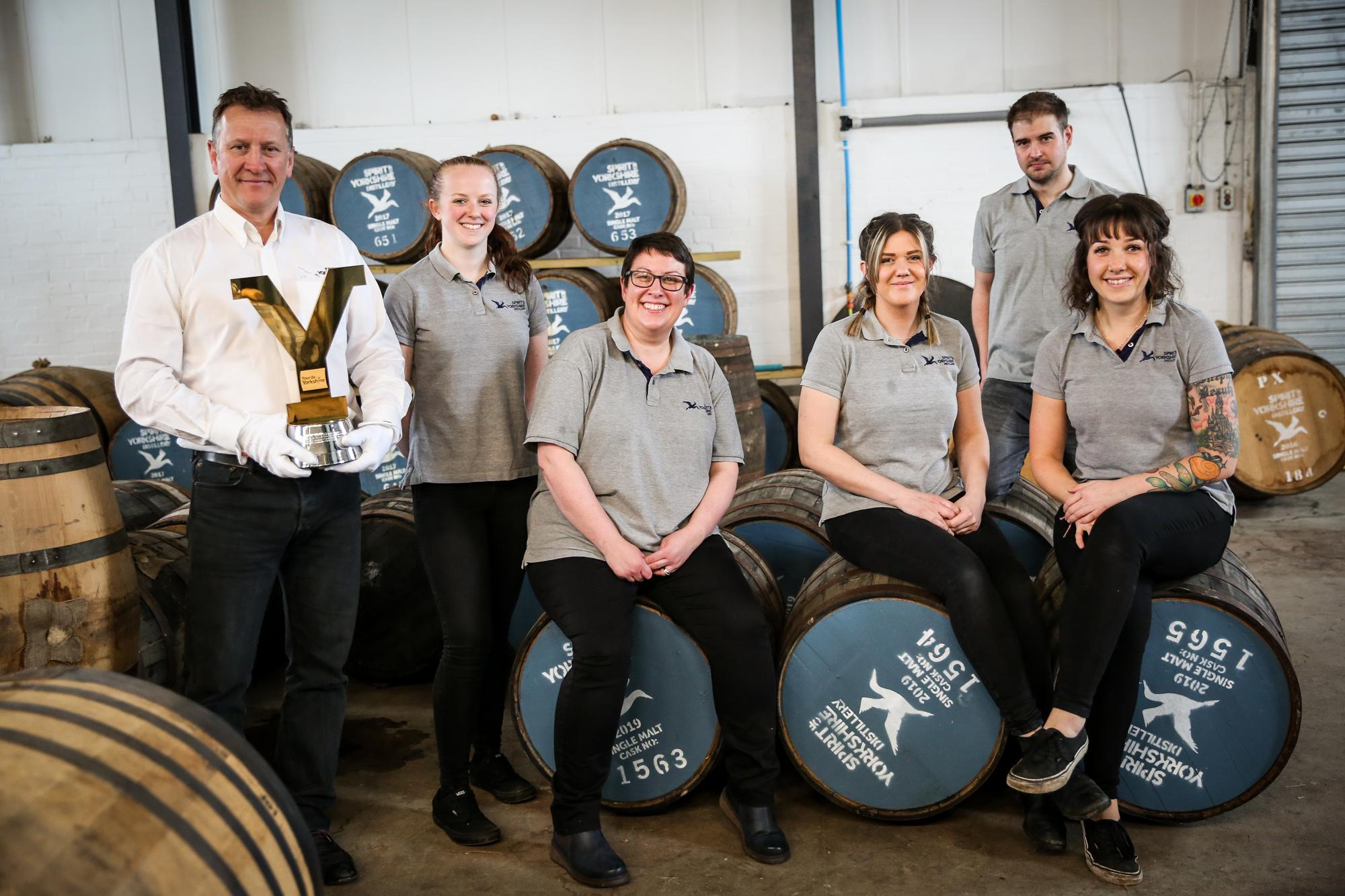 Picture of Spirit of Yorkshire Distillery owner, David Thompson, with his team and the Tour de Yorkshire trophy. Picture credit: Ceri Oakes Photography