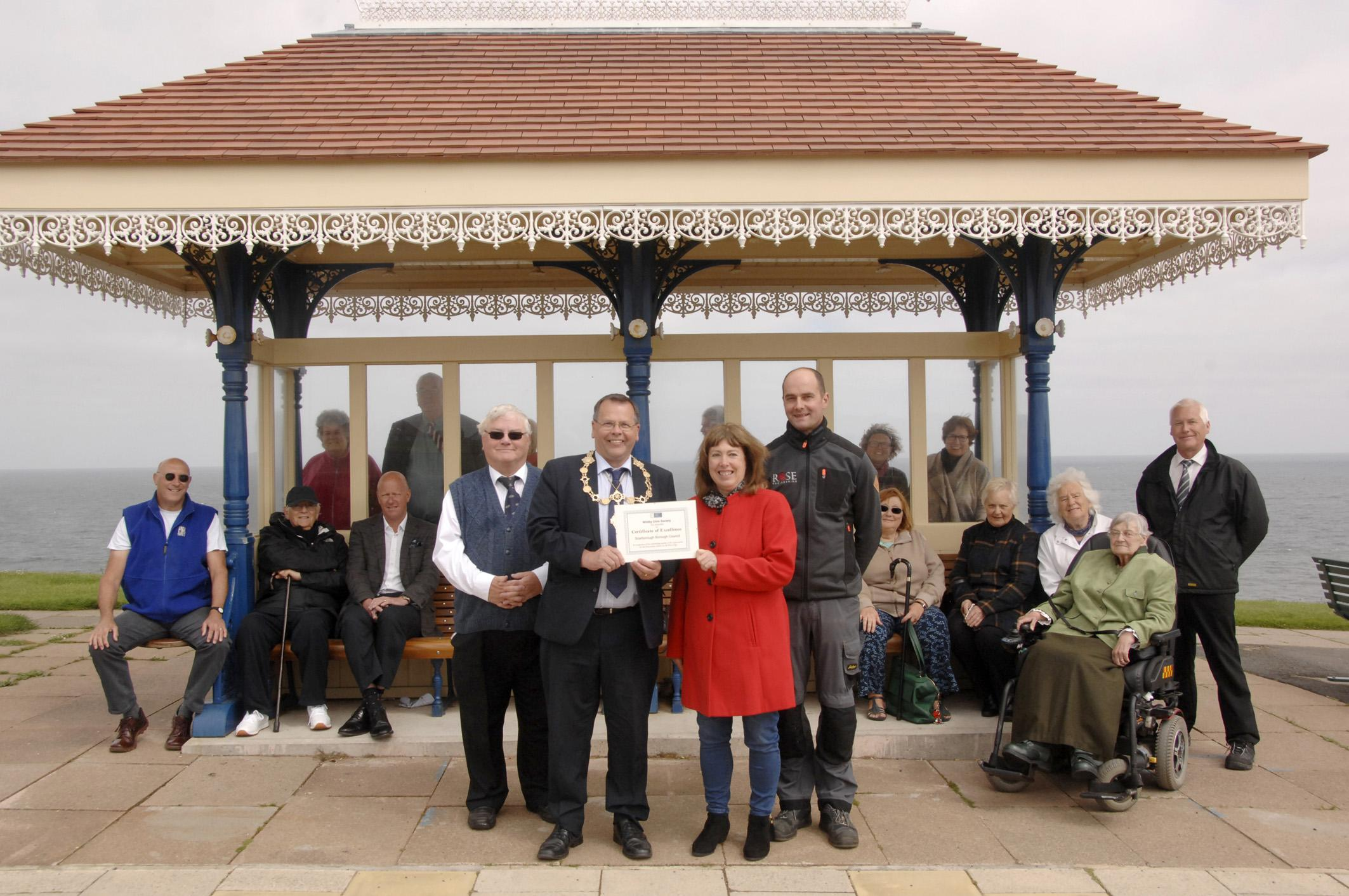 Picture of presentation of certificate of excellence at Whitby West Cliff shelters